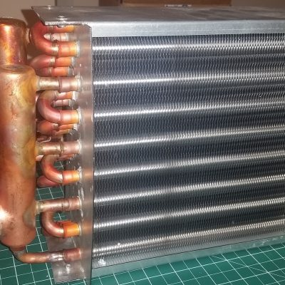 7kW Copper Radiator for the primary loop heat exchanger of the closed loop diffusion pump chiller.