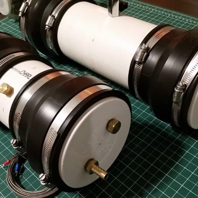 "4"" PVC primary and secondary cooling tanks with brass hose fittings, fill ports, and thermocouple gauges for the closed loop diffusion pump cooling system."